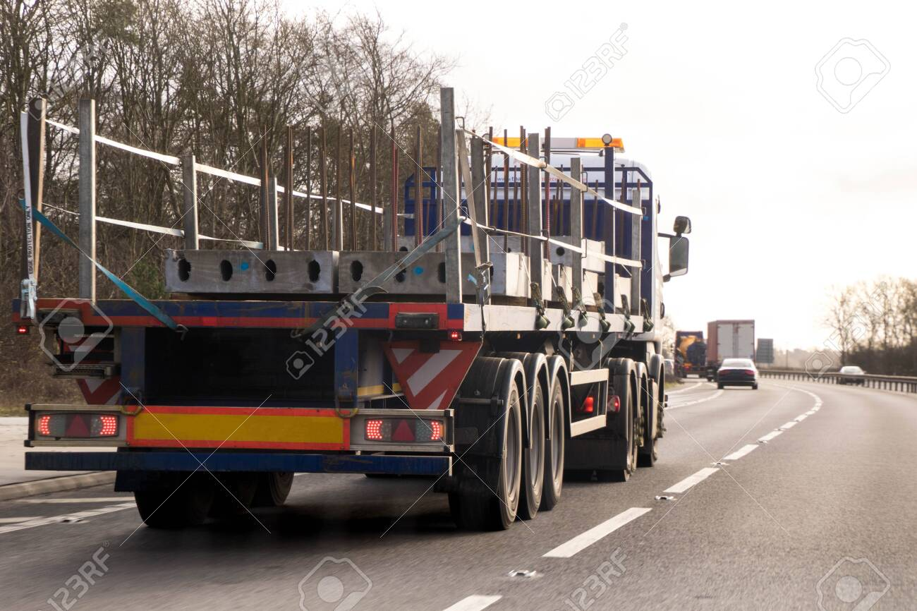 A large HGV travels across country to deliver or collect goods for the next business location. - 138110574