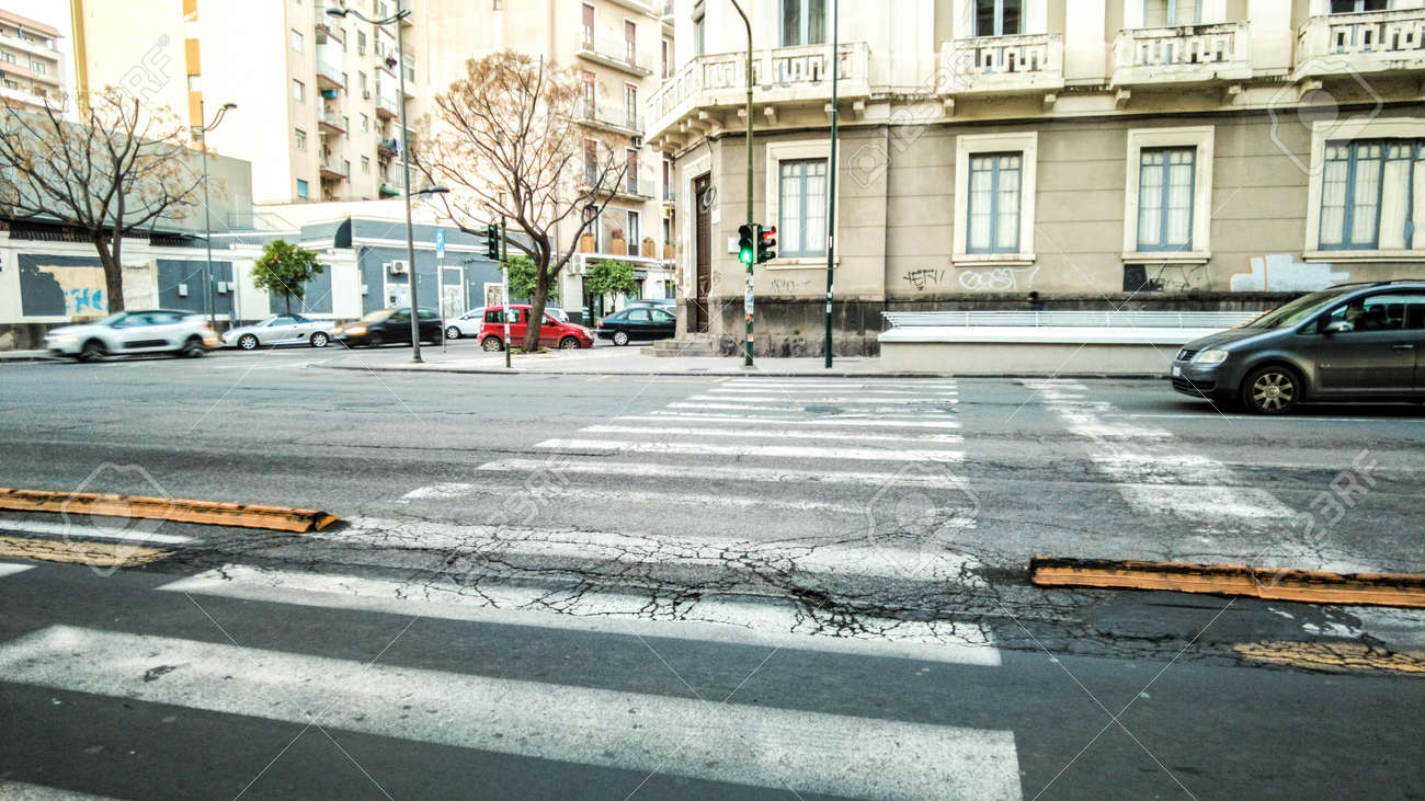 A typical road crossing for pedestrians in the center of Catania City, in Sicily, Italy. - 166119178