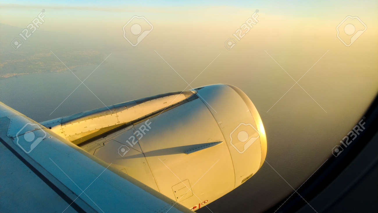 A view from a passenger window of a large aircraft traveling across the world on a holiday or business trip. - 166119405