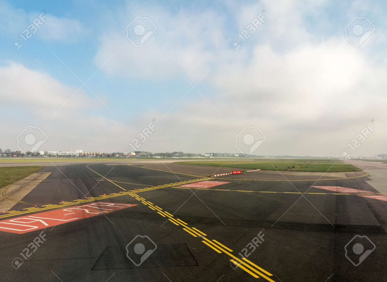 A passenger view from onboard a passenger aircraft of an airport area before the plane departs or just after it has arrived. - 166119415