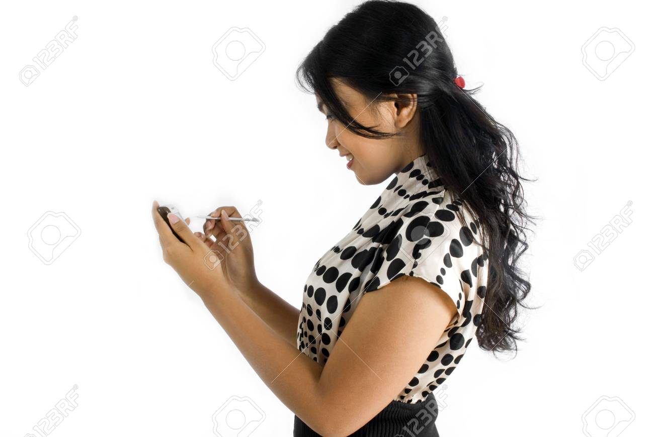 Side view of Female asian business woman using PDA Stock Photo - 4756389