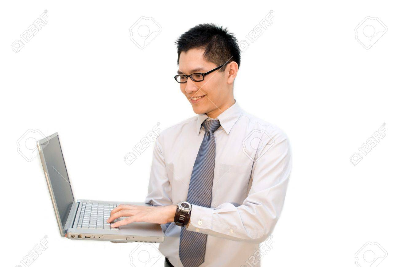 Nerdy Asian business male working on laptop Stock Photo - 4969587
