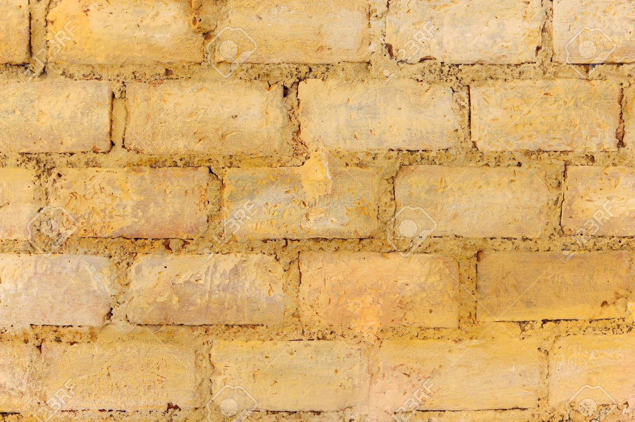 Texture Of Old Rustic Wall Of Yellow Bricks Stock Photo, Picture And ...