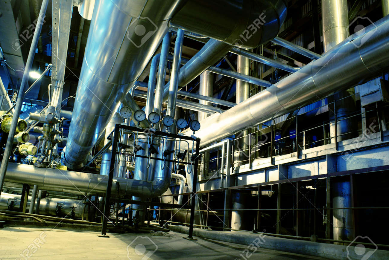 Pipes, tubes, machinery and steam turbine at a power plant Stock Photo - 3608387