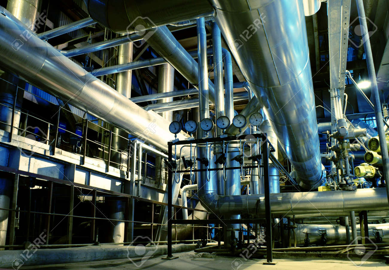 Pipes, tubes, machinery and steam turbine at a power plant Stock Photo - 4283193