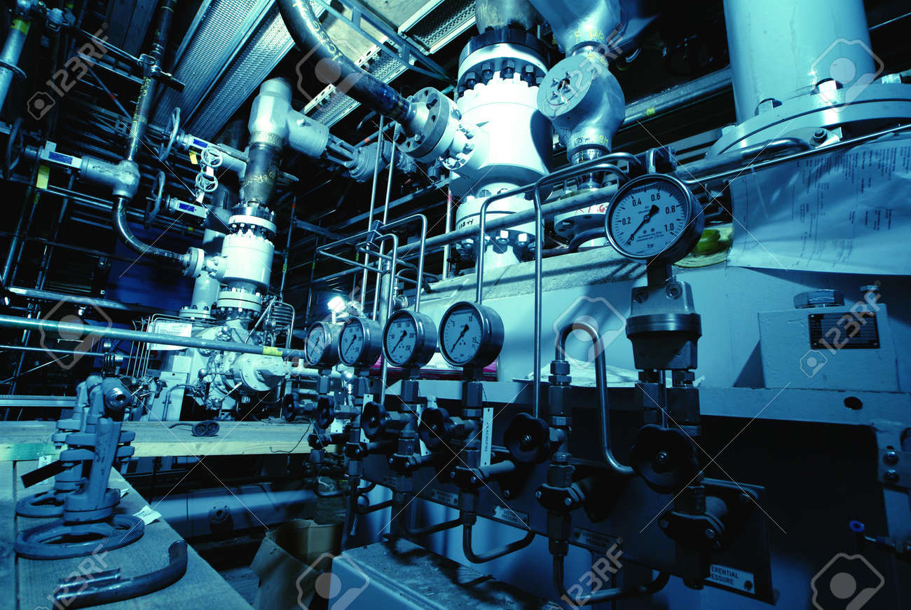 Pressure gauges connected with many metallic pipes, interior of water treatment plant Stock Photo - 5044104