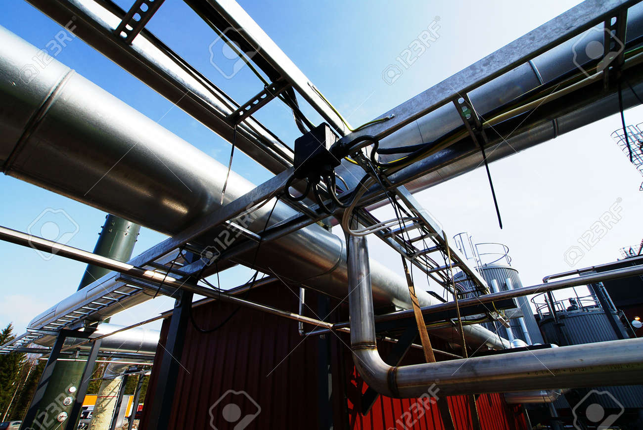 Industrial zone, Steel pipelines and valves against blue sky Stock Photo - 8282613