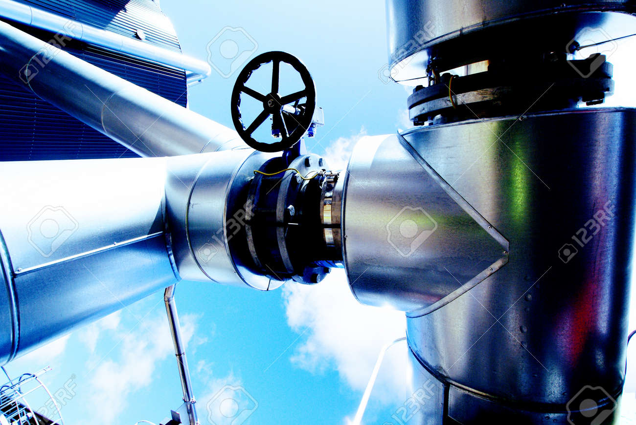 Industrial zone, Steel pipelines and valves against blue sky Stock Photo - 9238741