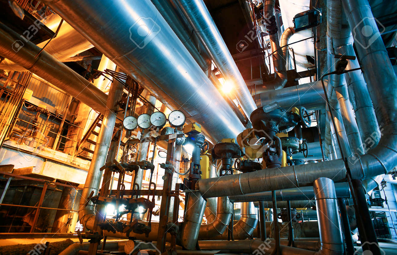 Equipment, cables and piping as found inside of a modern industrial power plant - 155625177