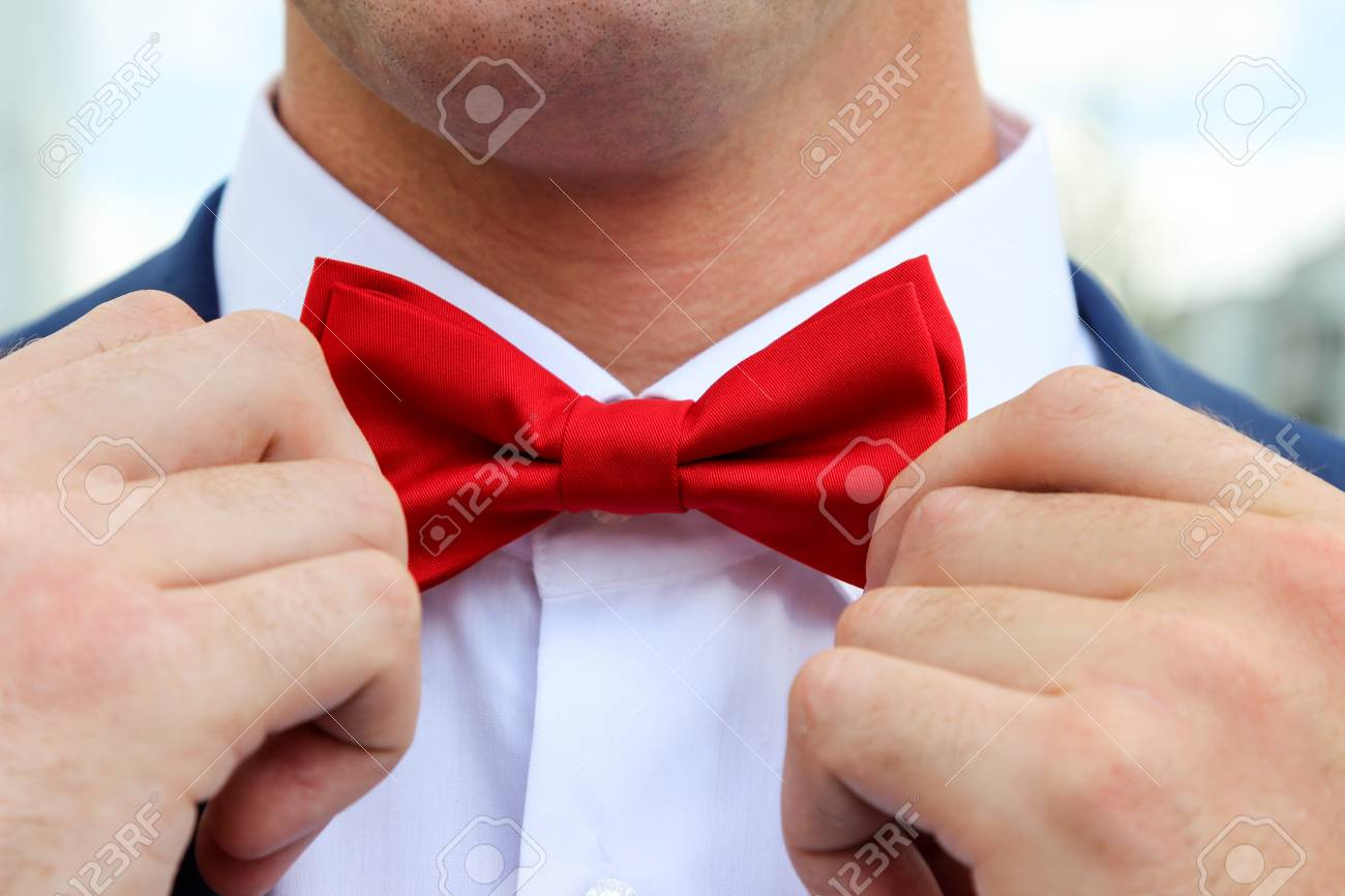 cb132dcc Men's Hands Are Readjusting Red Bow Tie Stock Photo, Picture And ...