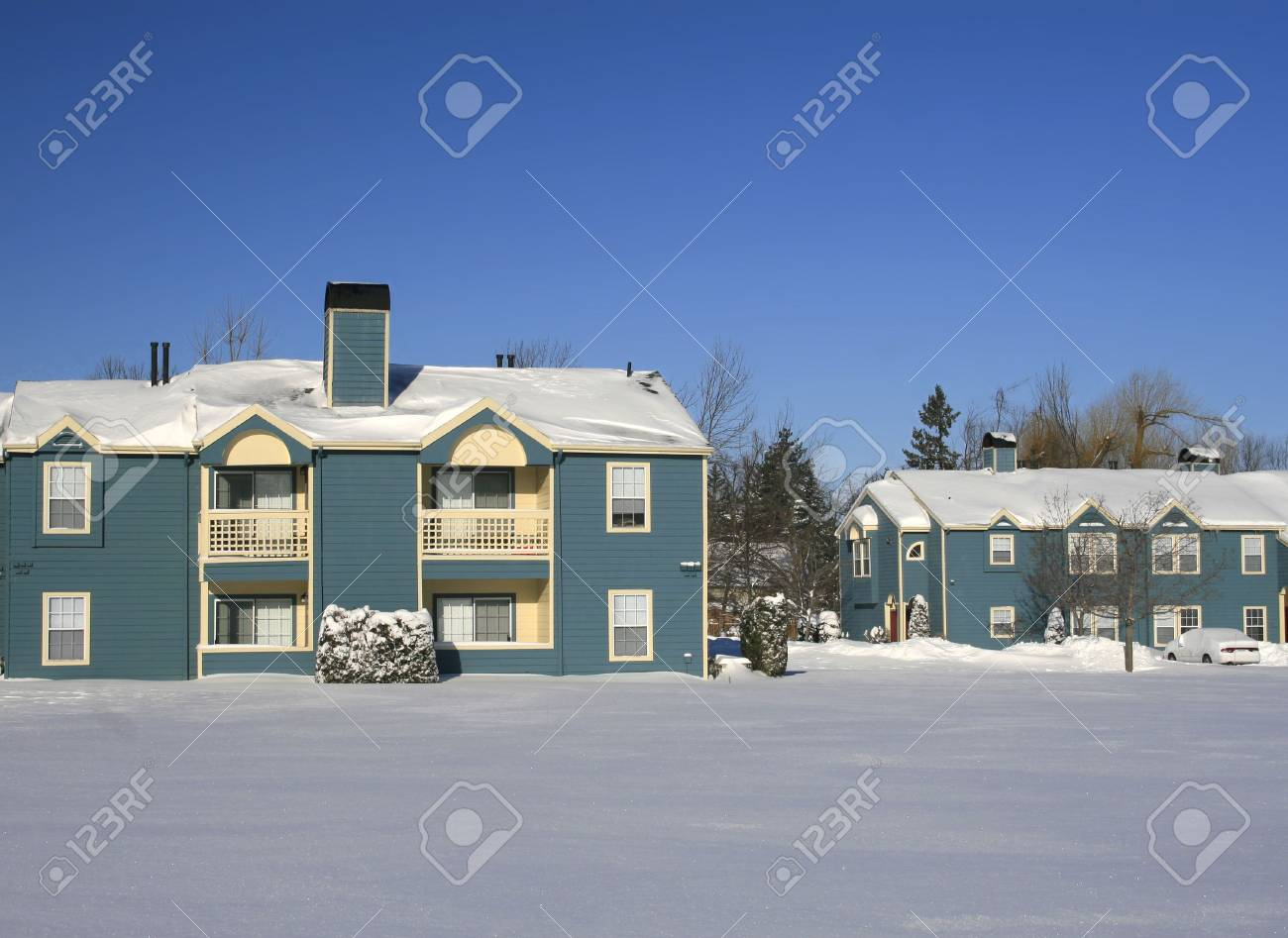View of a snow covered house in a housing communiy area, street, in winter Stock Photo - 2813143
