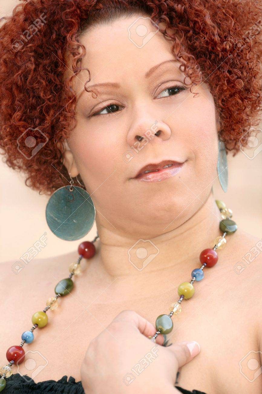 Portrait Of A Female With Short Curly Red Hair And Bright Jewelry Stock Photo Picture And Royalty Free Image Image 3765307