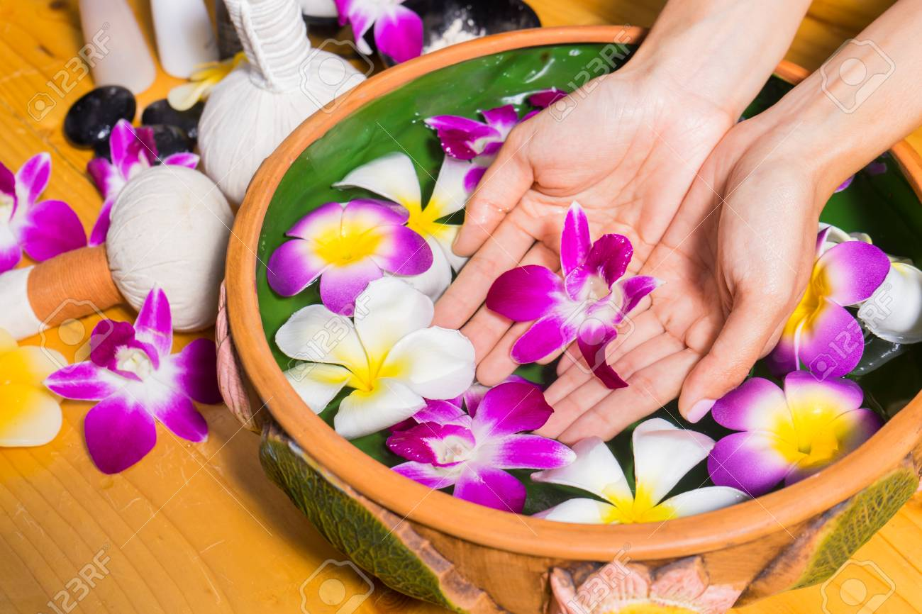 Woman Hands With A Bowl Of Aroma Spa Water On Wooden Table Spa Stock Photo Picture And Royalty Free Image Image 66381378