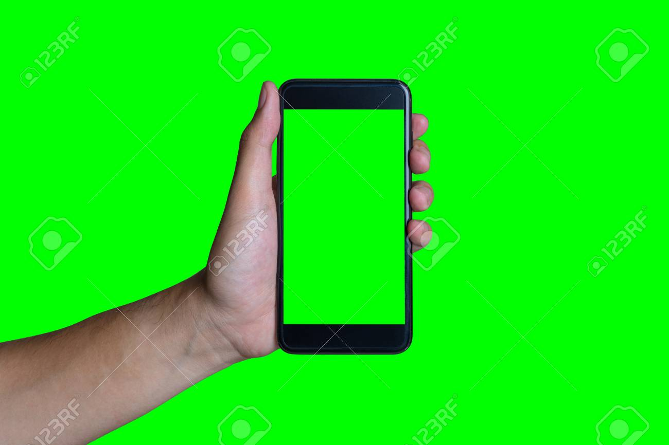 man s hand shows mobile smartphone with green screen in vertical