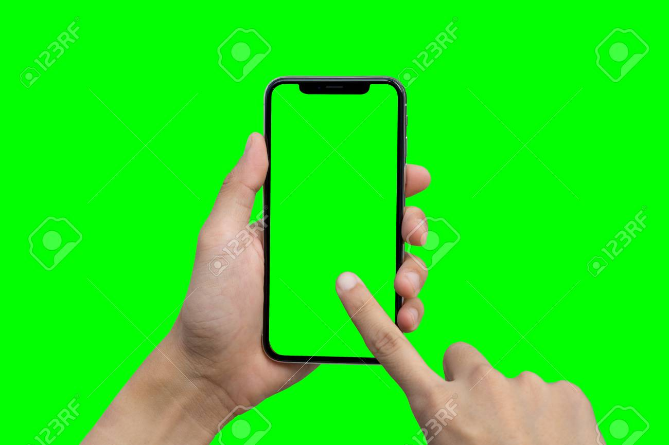 Man's hand shows mobile smartphone with green screen in vertical position isolated on green background - 94316849
