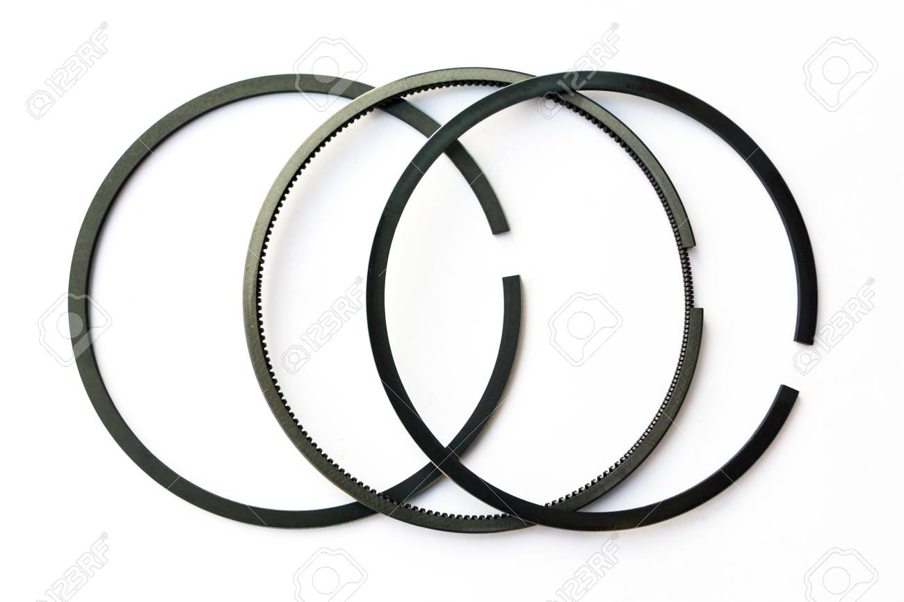 new car piston rings on isolated white background close-up