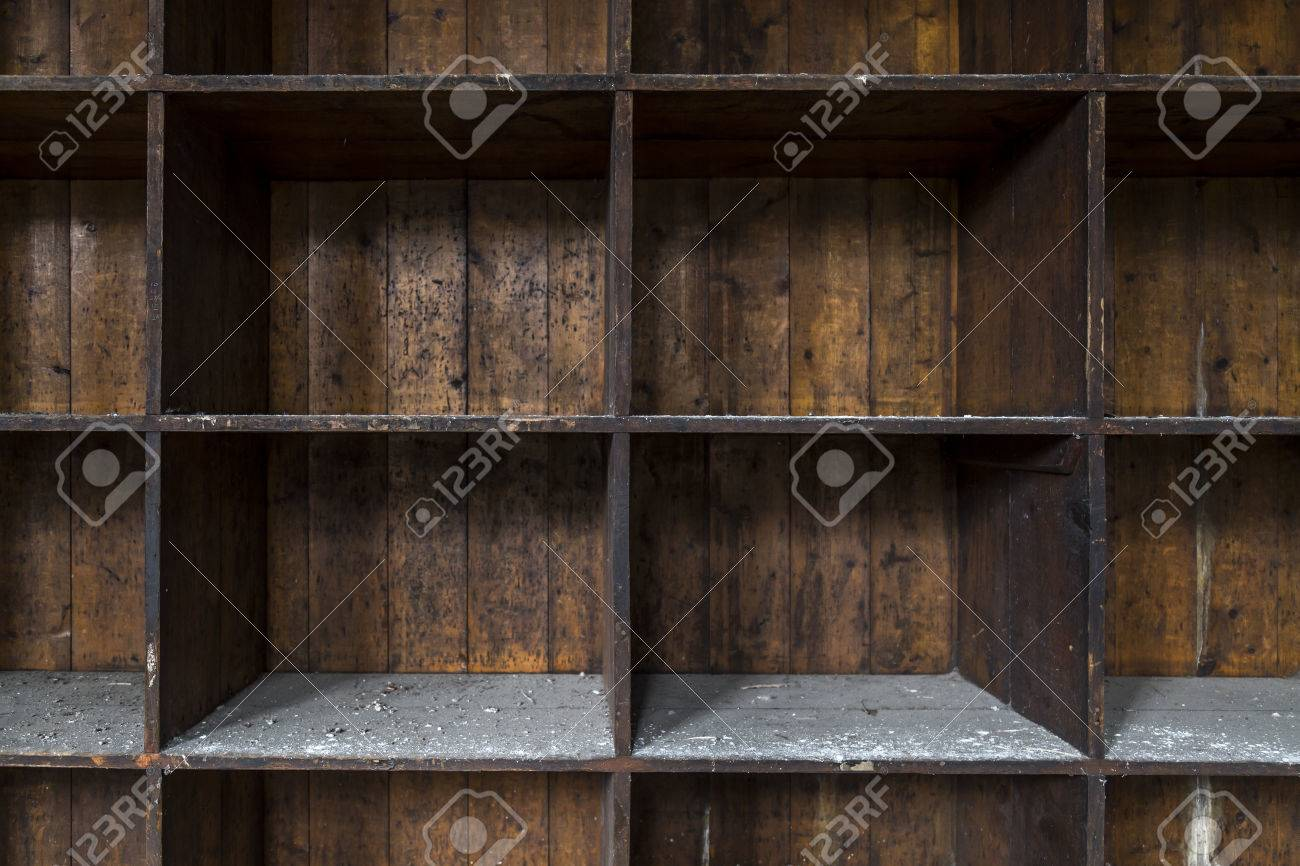 Exceptionnel An Old And Distressed, Dark Wood Shelf. Made Of Empty Boxes Covered With  Dust