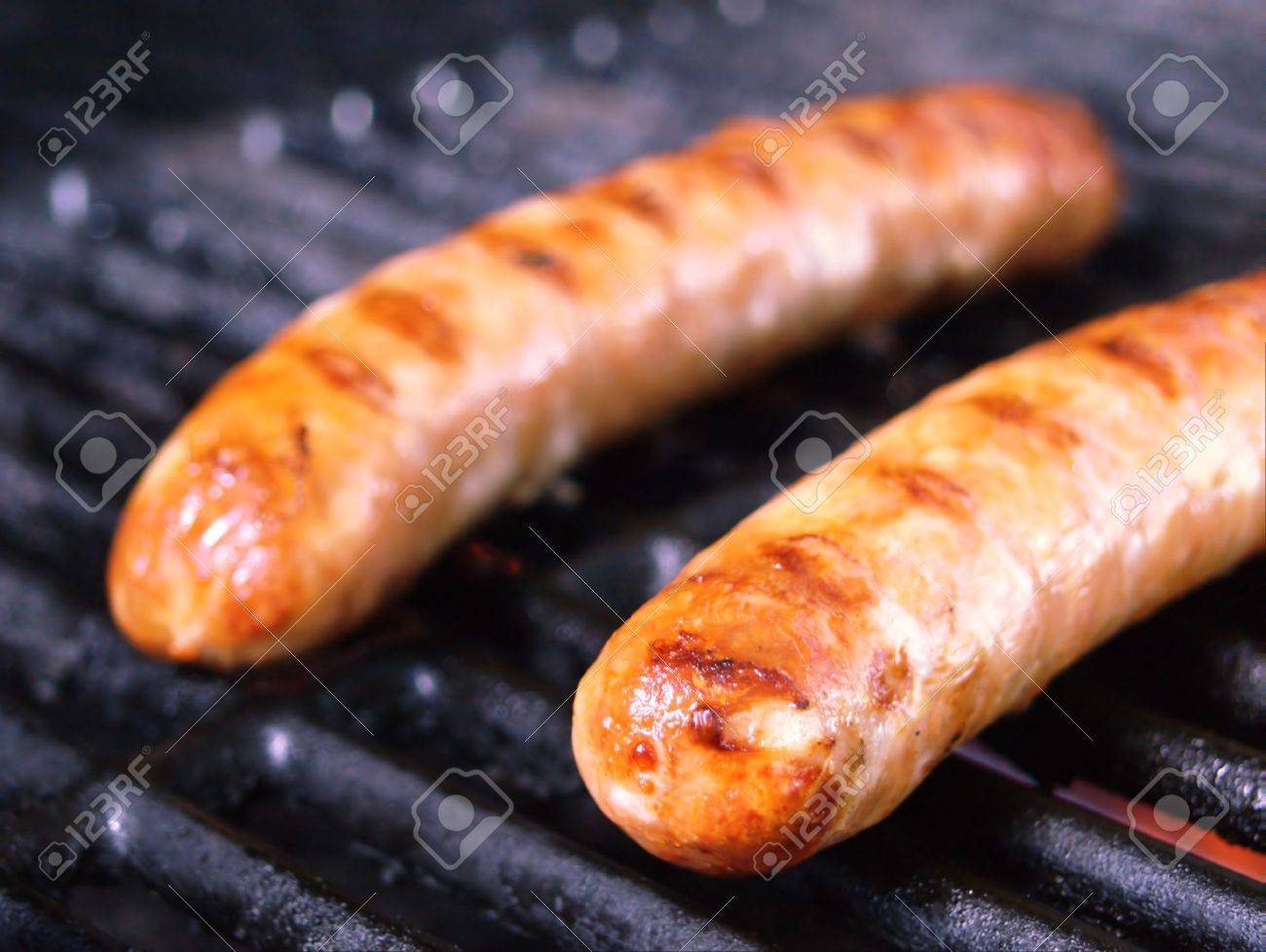 http://previews.123rf.com/images/novatrader/novatrader1303/novatrader130300073/18784113-Two-large-juicy-German-sausages-cooking-on-a-barbecue-Stock-Photo.jpg