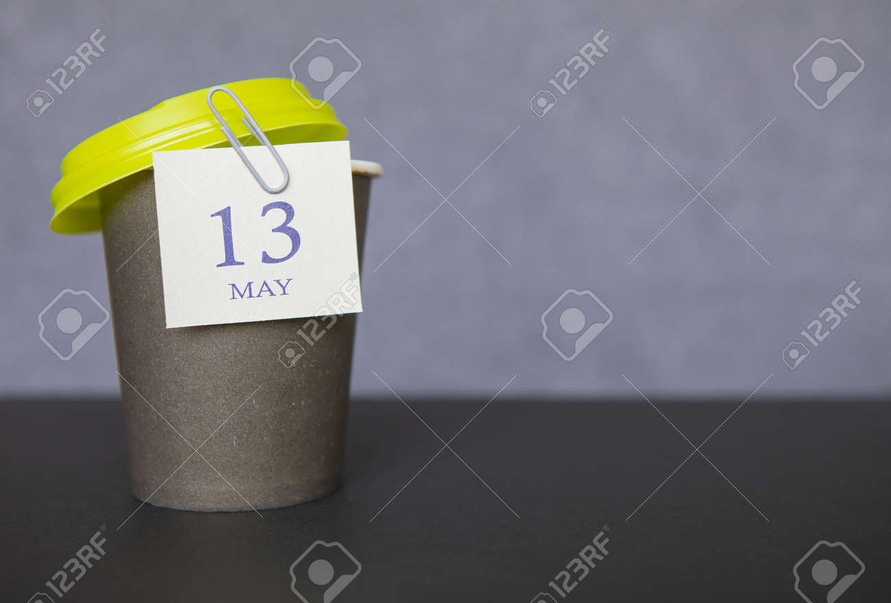 Coffee paper cup with calendar dates for May 13, Spring season. Time for relaxing breaks and vacations. - 153366750