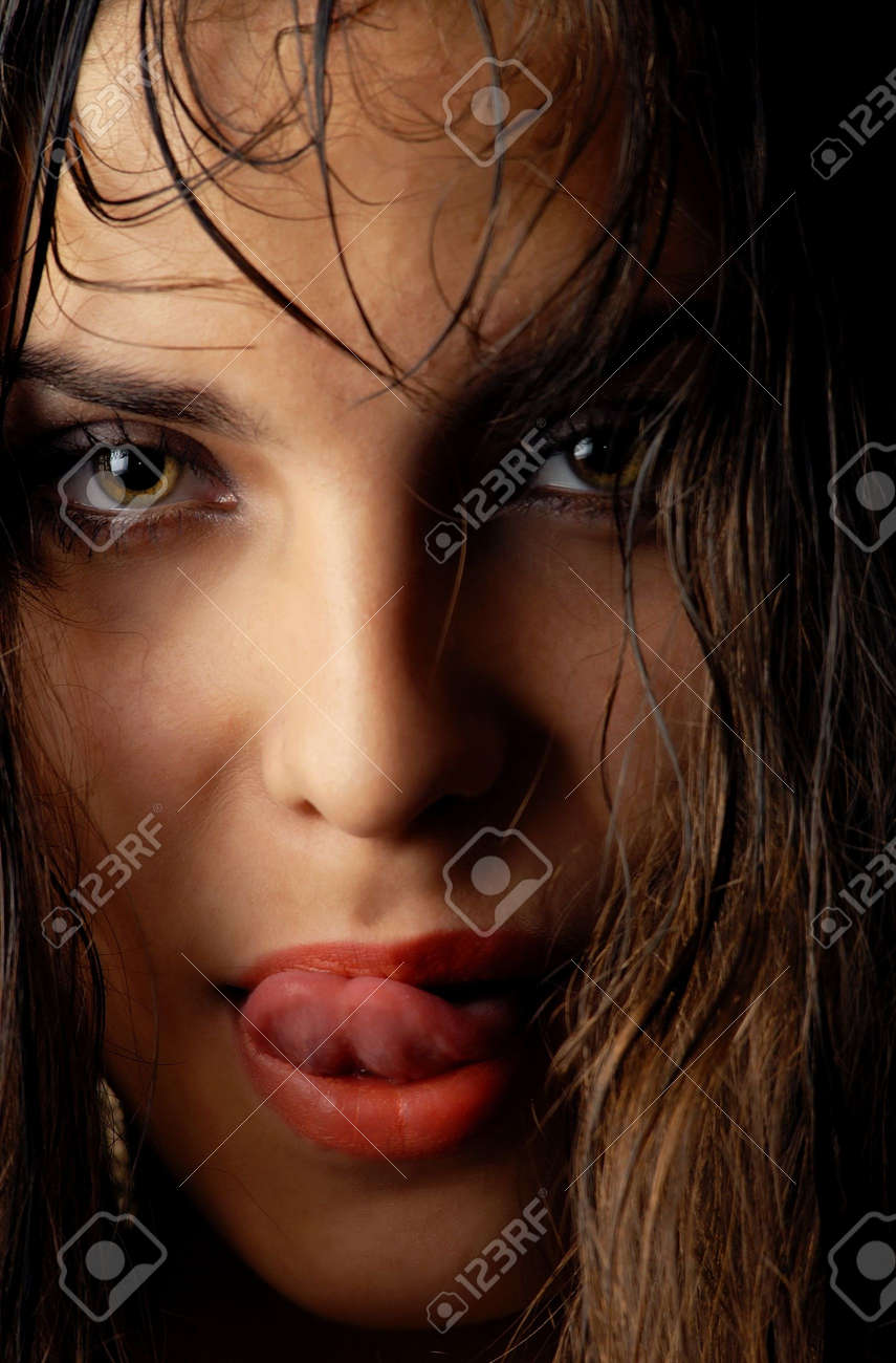 Sensual woman moistening her lips with wet hairs Stock Photo - 1335315