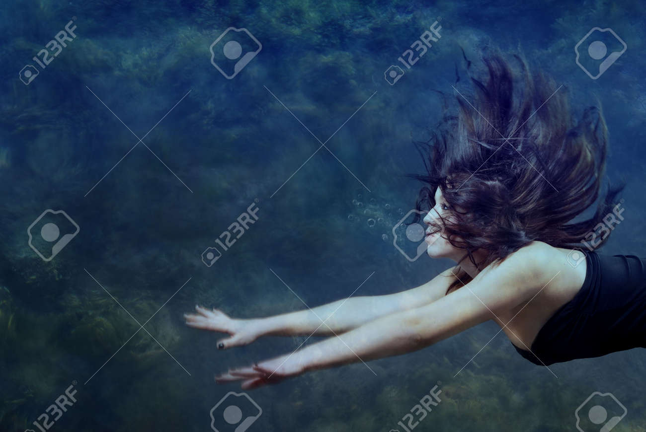 Beautiful lady swimming and diving underwater - 4085278