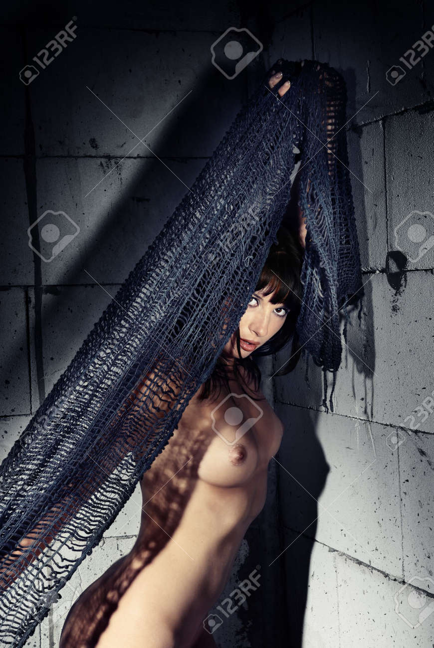 Naked woman with textile near the wall Stock Photo - 4102660