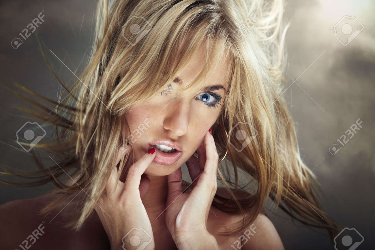 Sexy blond woman outdoors with moving hairs Stock Photo - 4207198