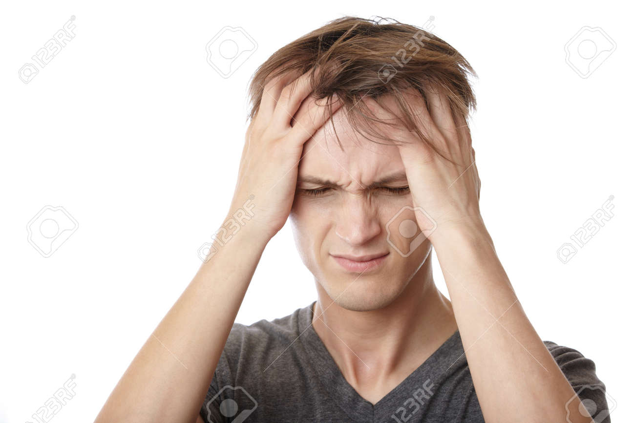 Young man feeling emotional stress and headache - 10282179