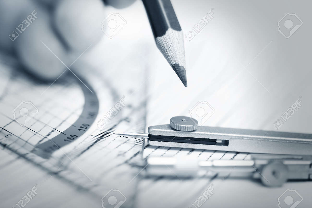Human hand drawing engineering scheme with red pencil  Close-up photo Stock Photo - 13815530