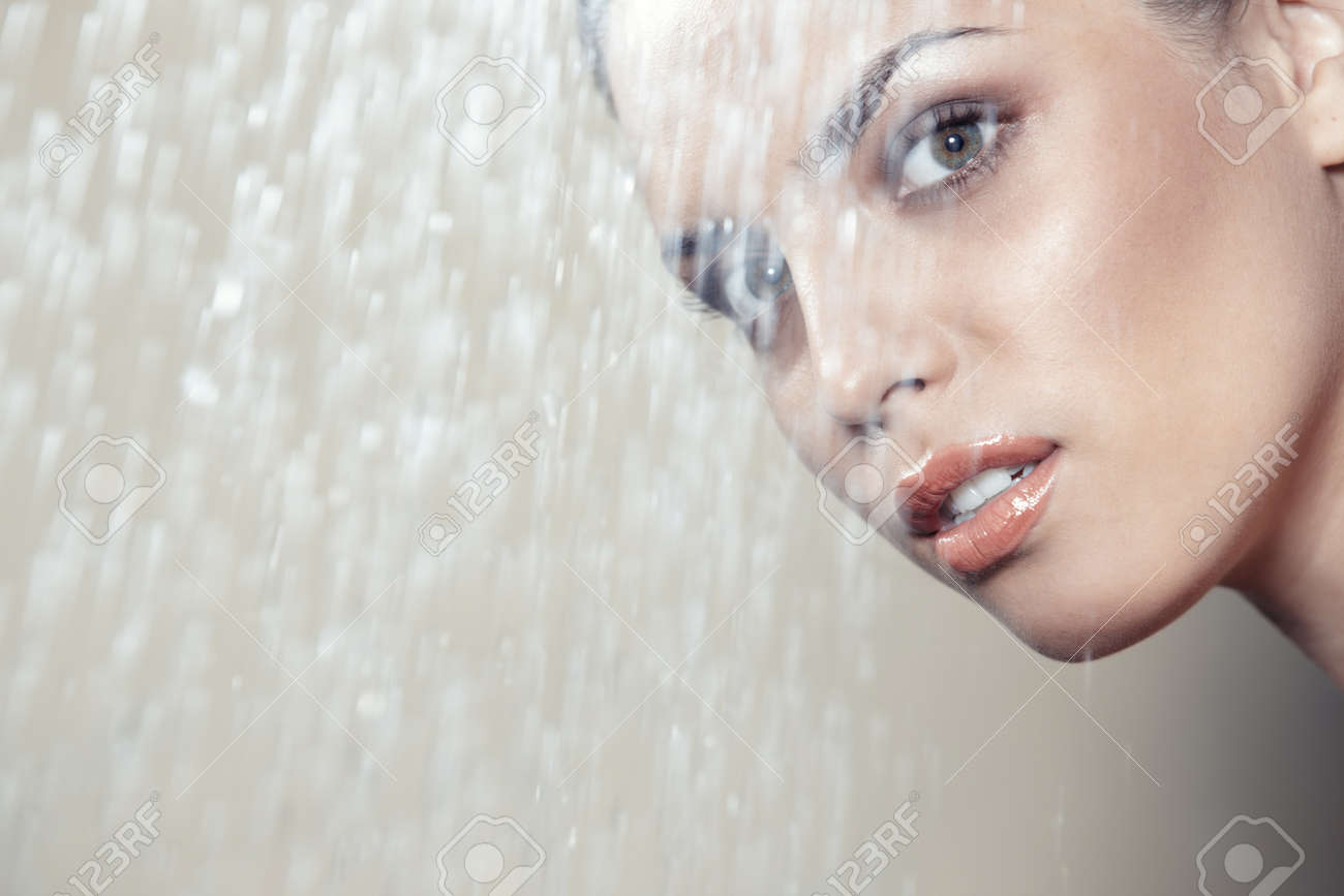 Attractive lady behind the water falling - 14477771