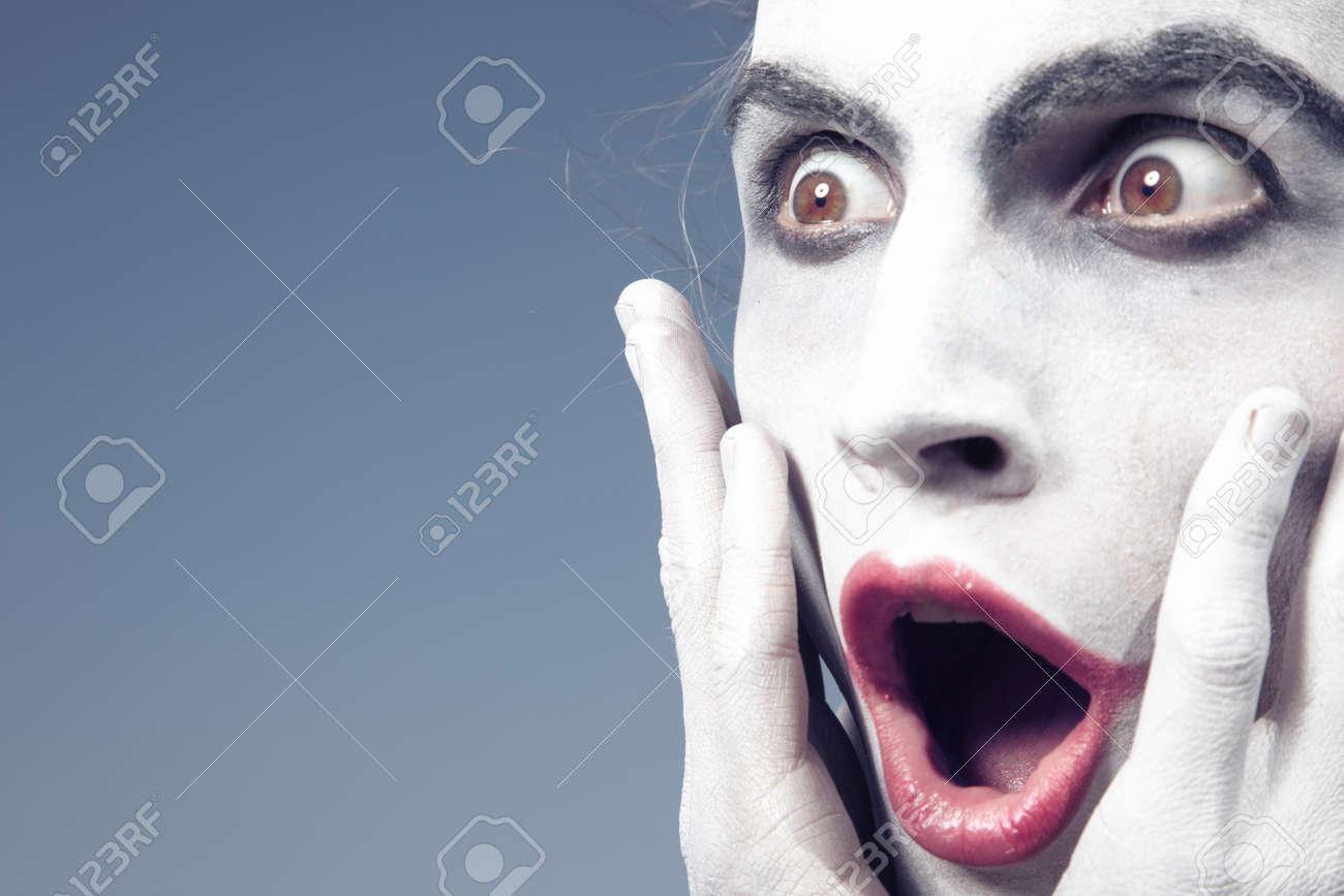 Man with white makeup expressing shock - 15408323