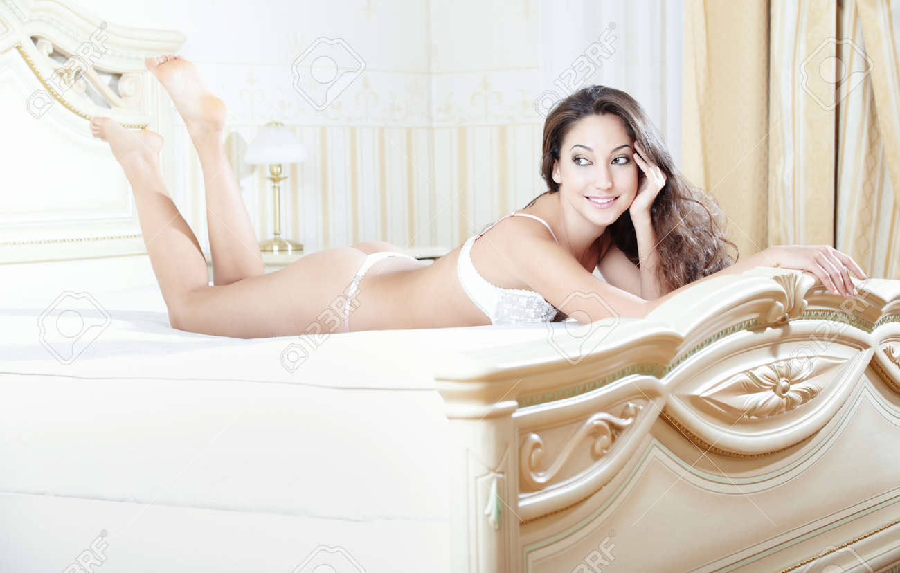 Smiling lady lying and pamepring in bedroom Stock Photo - 17213768