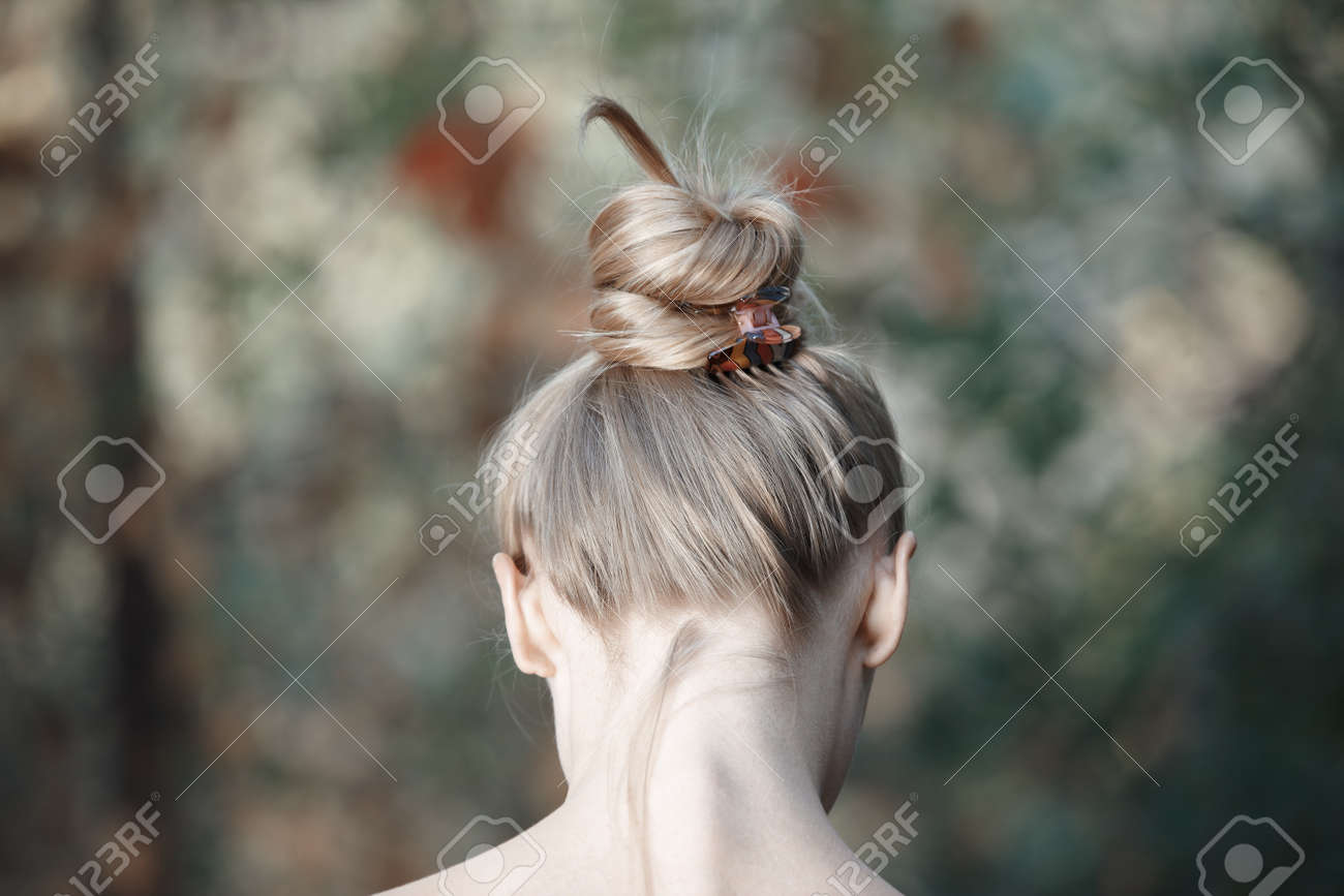 Rear view on the head of young woman outdoors - 18676082