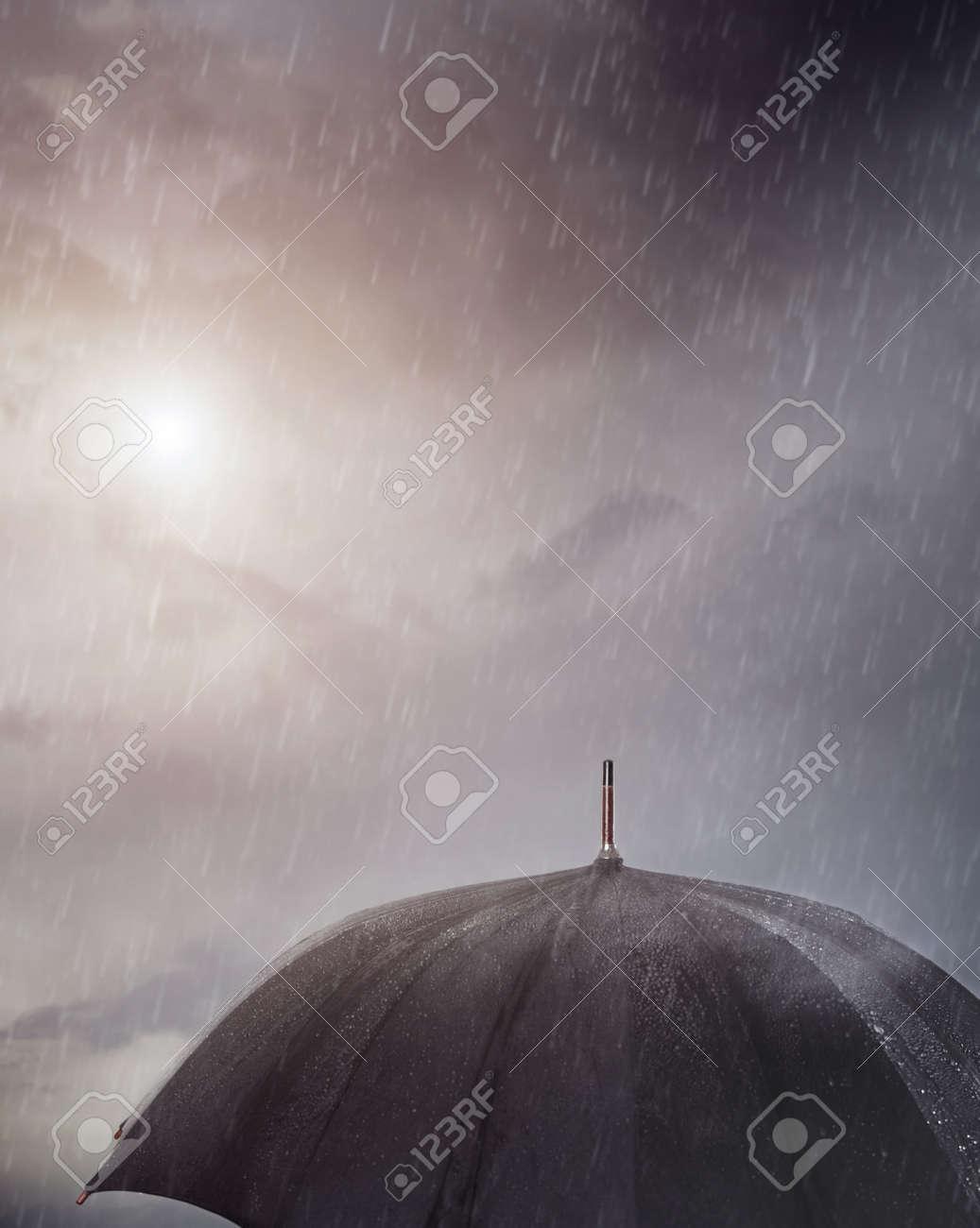 Wet umbrella under the rain - 18853831