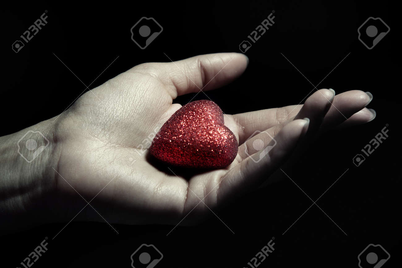 Woman hand holding a small heart as a symbol of love stock photo woman hand holding a small heart as a symbol of love stock photo 26016268 biocorpaavc Images