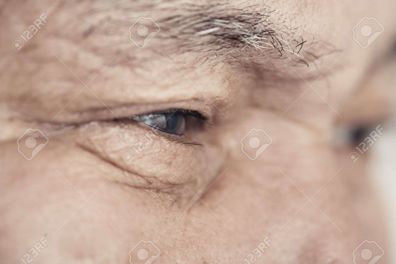 Close-up view on the eye of elderly human - 37867967