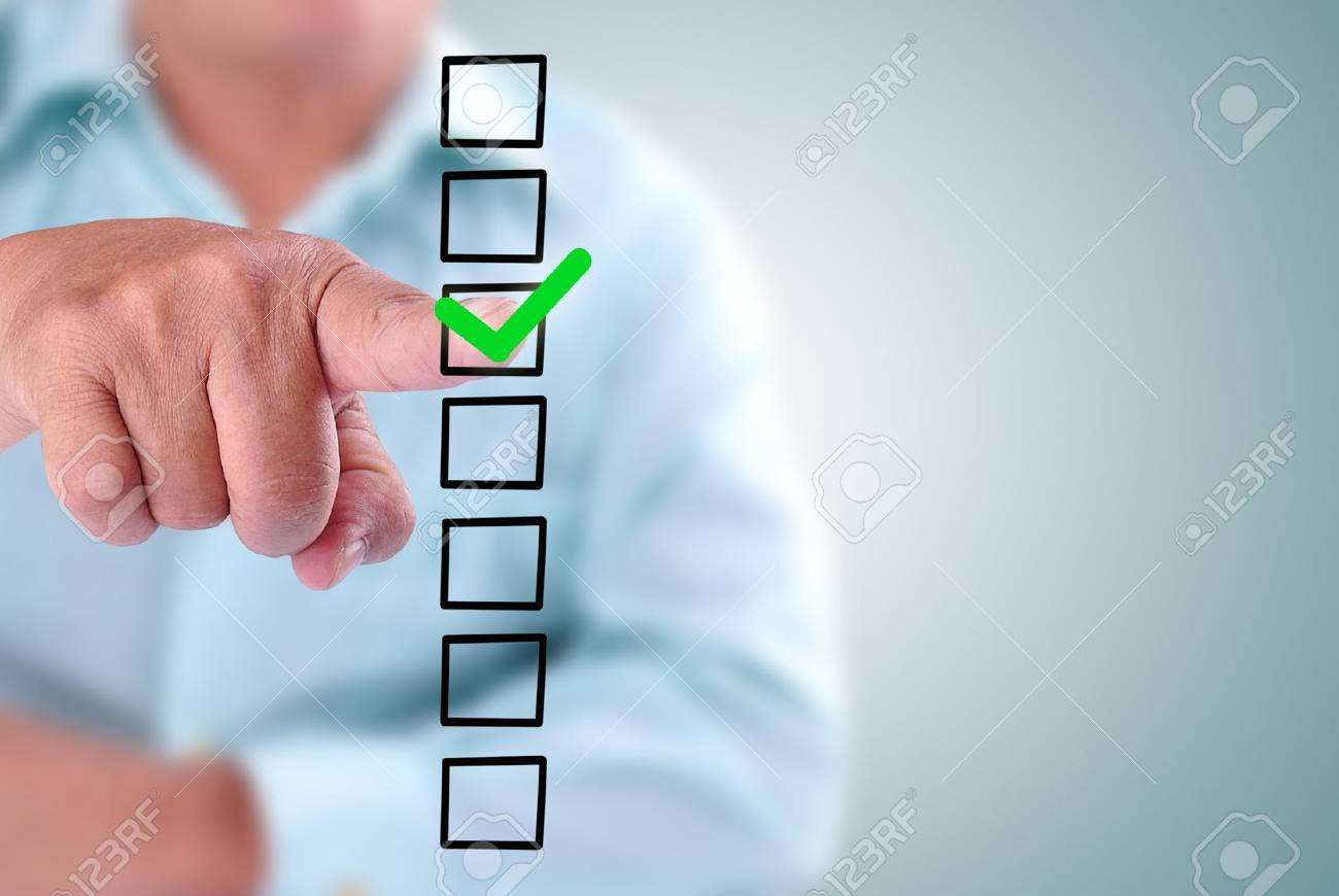 business man designed on a checklist box. With green checklist Stock Photo - 16588847