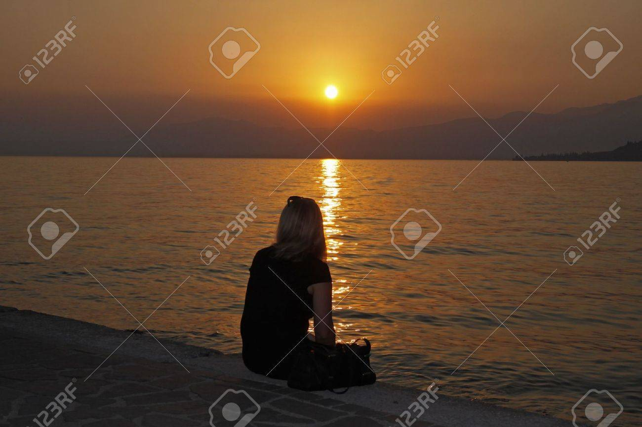 Woman looking over at the sunset Stock Photo - 9443289