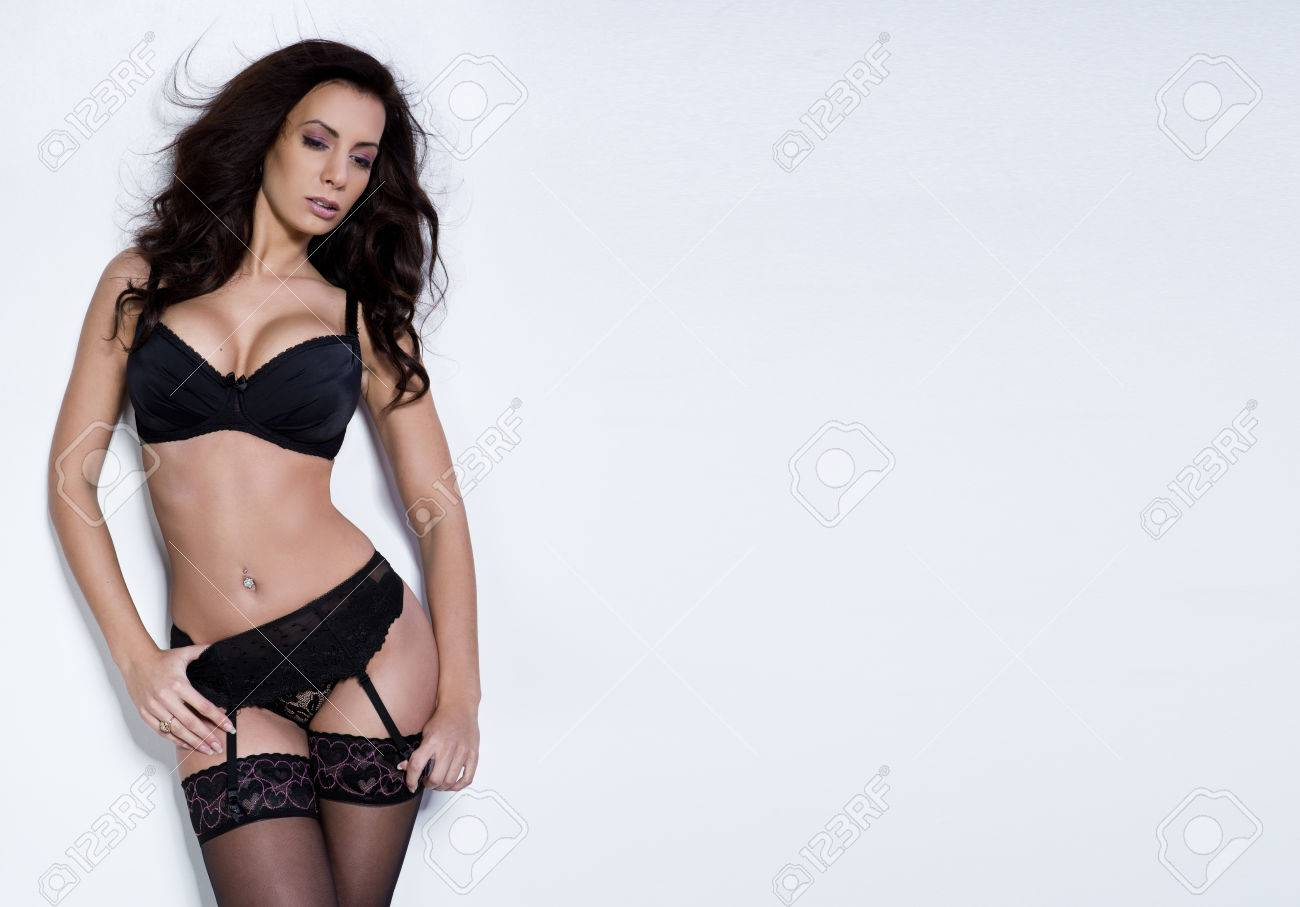 0a01cb157 Beautiful brunette young woman in sexy lingerie Stock Photo - 41441199