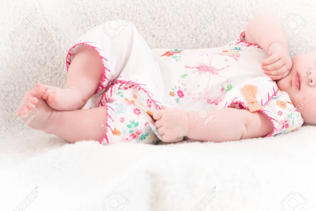 New-born baby lying in the bed - 147967883