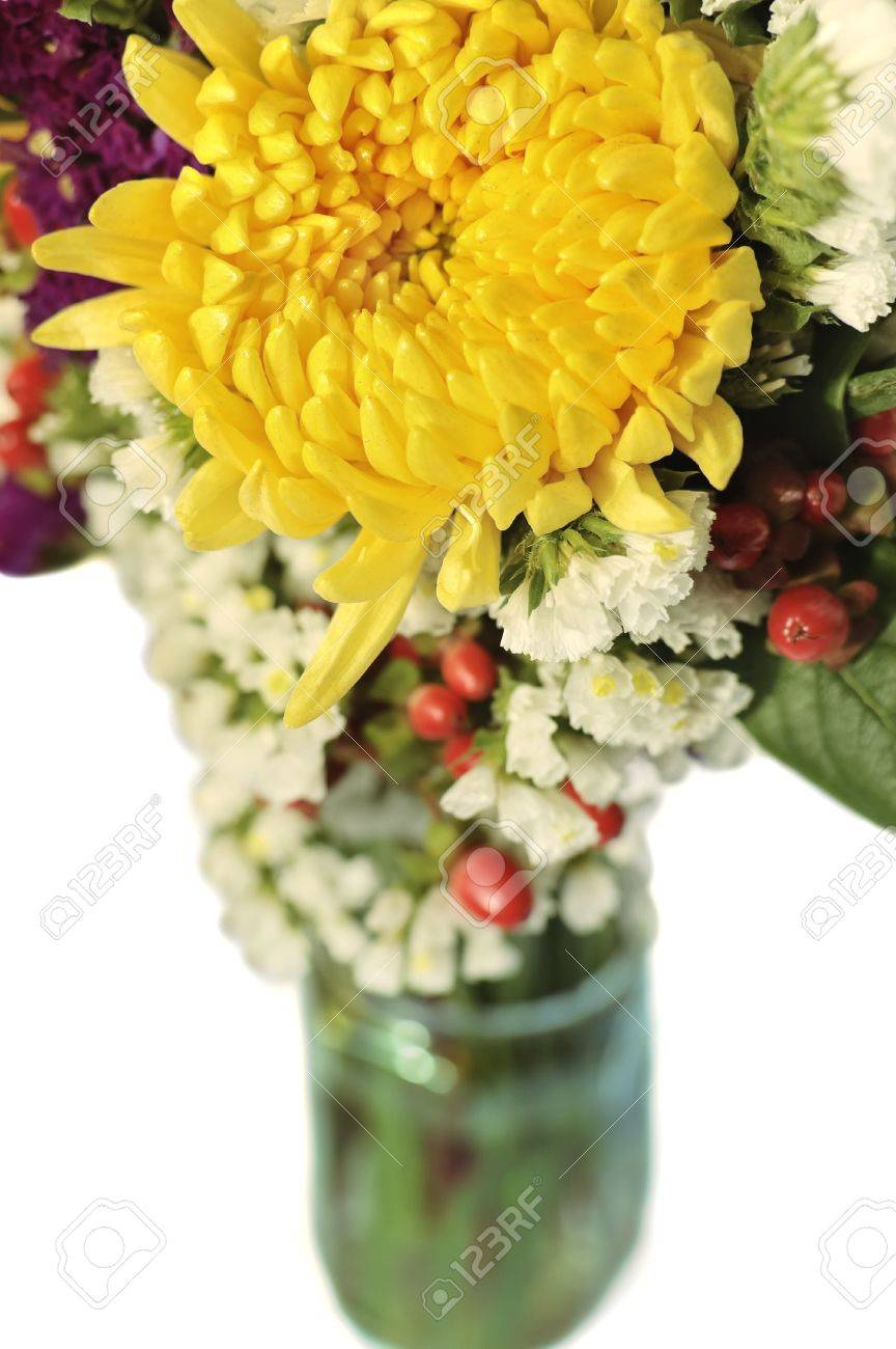 Yellow Purple And White Fresh Flower Bouquet In A Glass Jar Stock