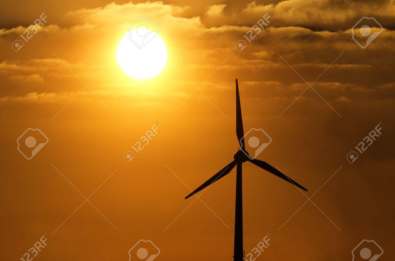 The wind and the sun are the most important sources of regenerative energy  The light of the setting sun gives the picture an agreeable warmth Stock Photo - 17759438