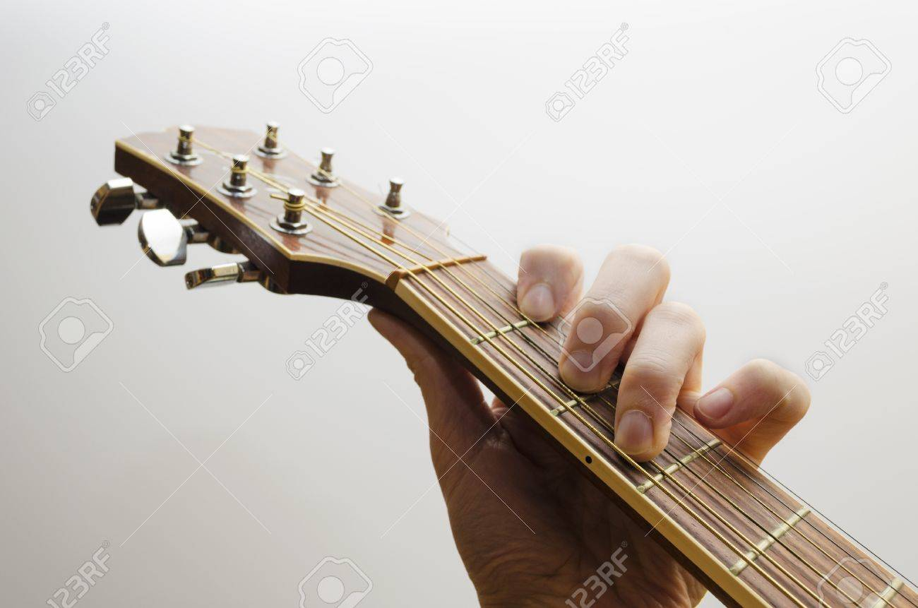 Neck Of An Acoustic Guitar A Hand Is Holding The C Major Chord