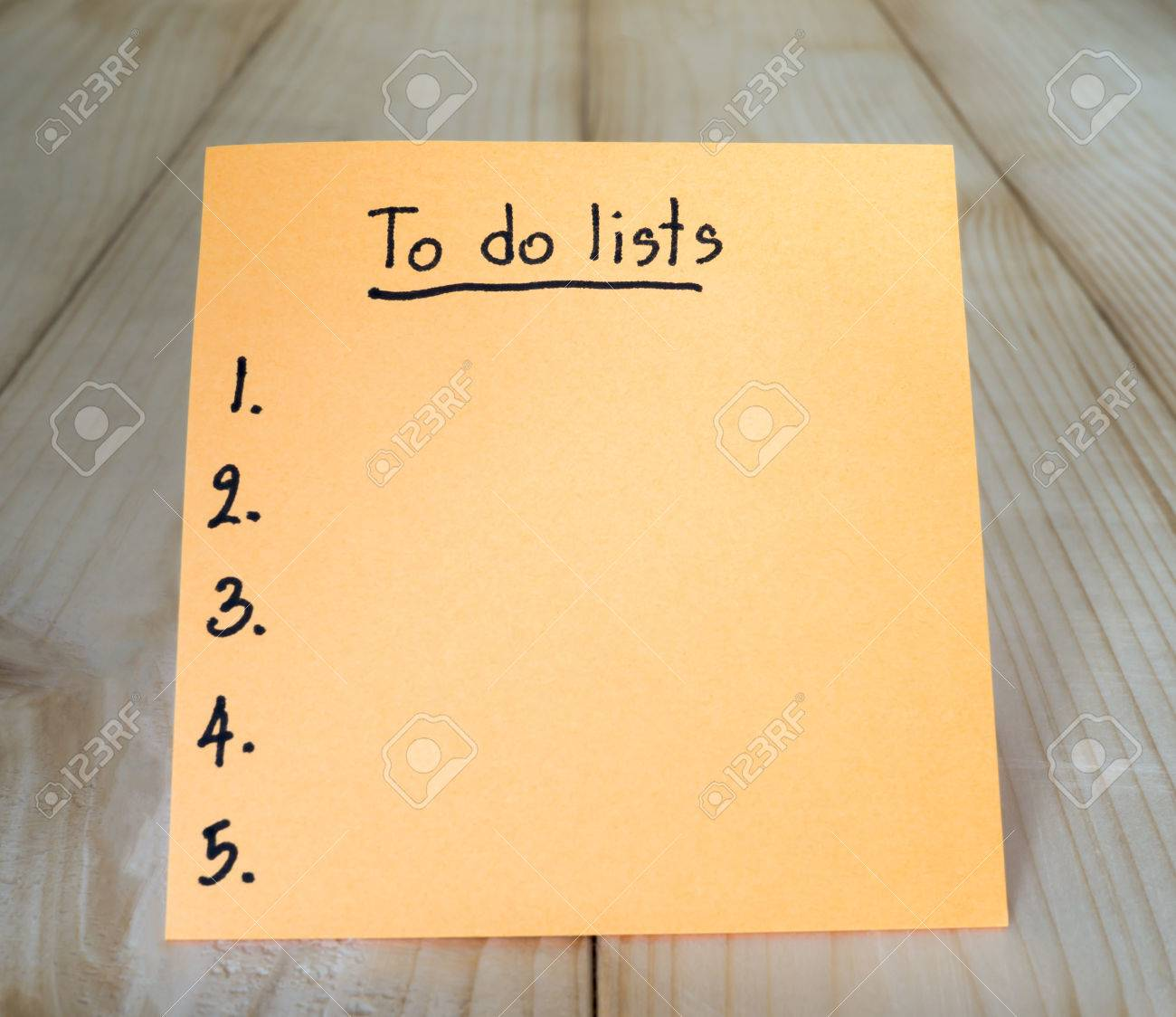 to do list on colorful sticky note with wood background stock photo