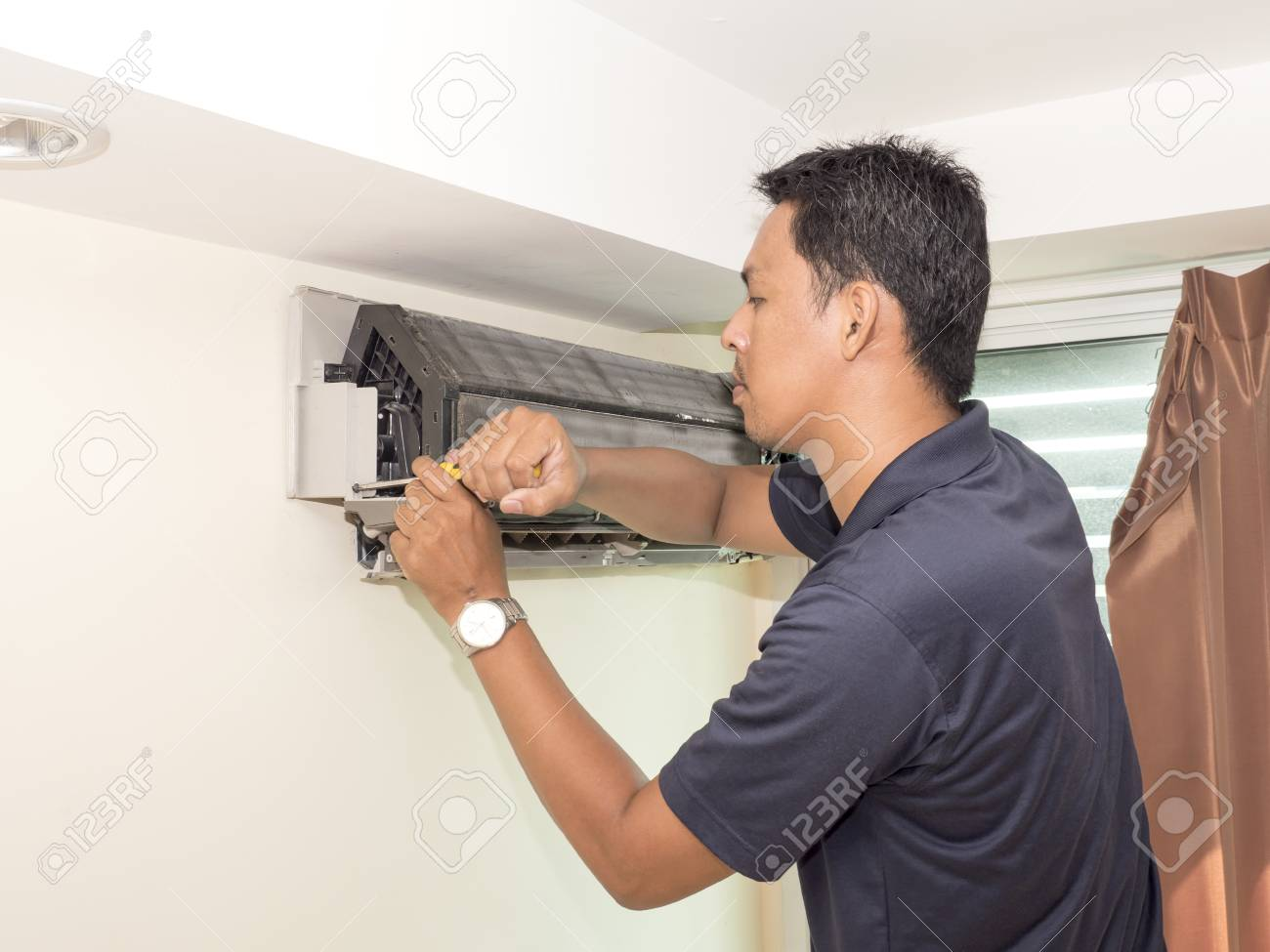 single electrician man clean, fix and maintain air conditioning