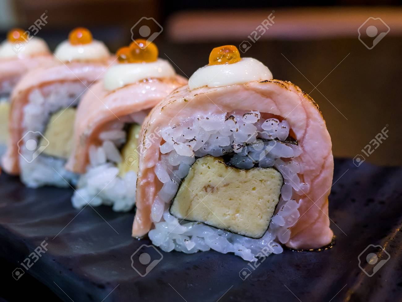 Closeup Grill Salmon Roll Sushi On Black Dish In The Restaurant Stock Photo Picture And Royalty Free Image Image 85947784
