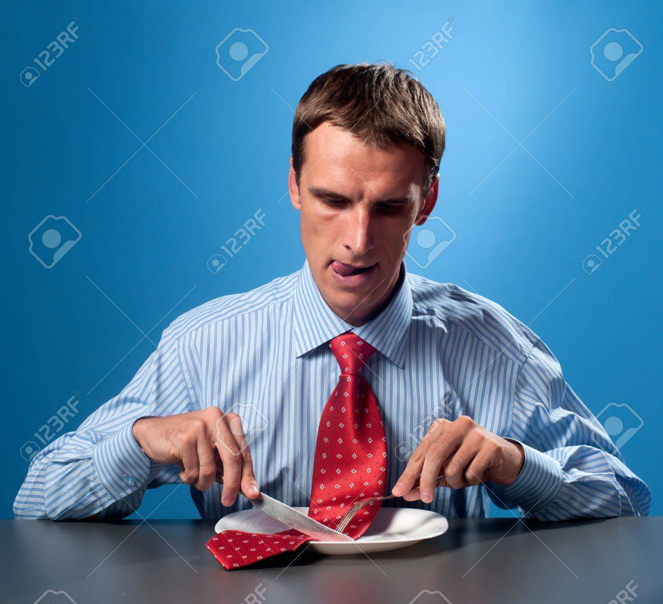 young man eating his red tie Stock Photo - 11035272