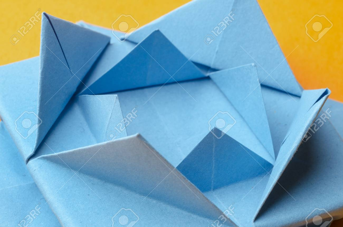 Abstract Closeup Of A Blue Stylized Paper Lotus Flower On Orange