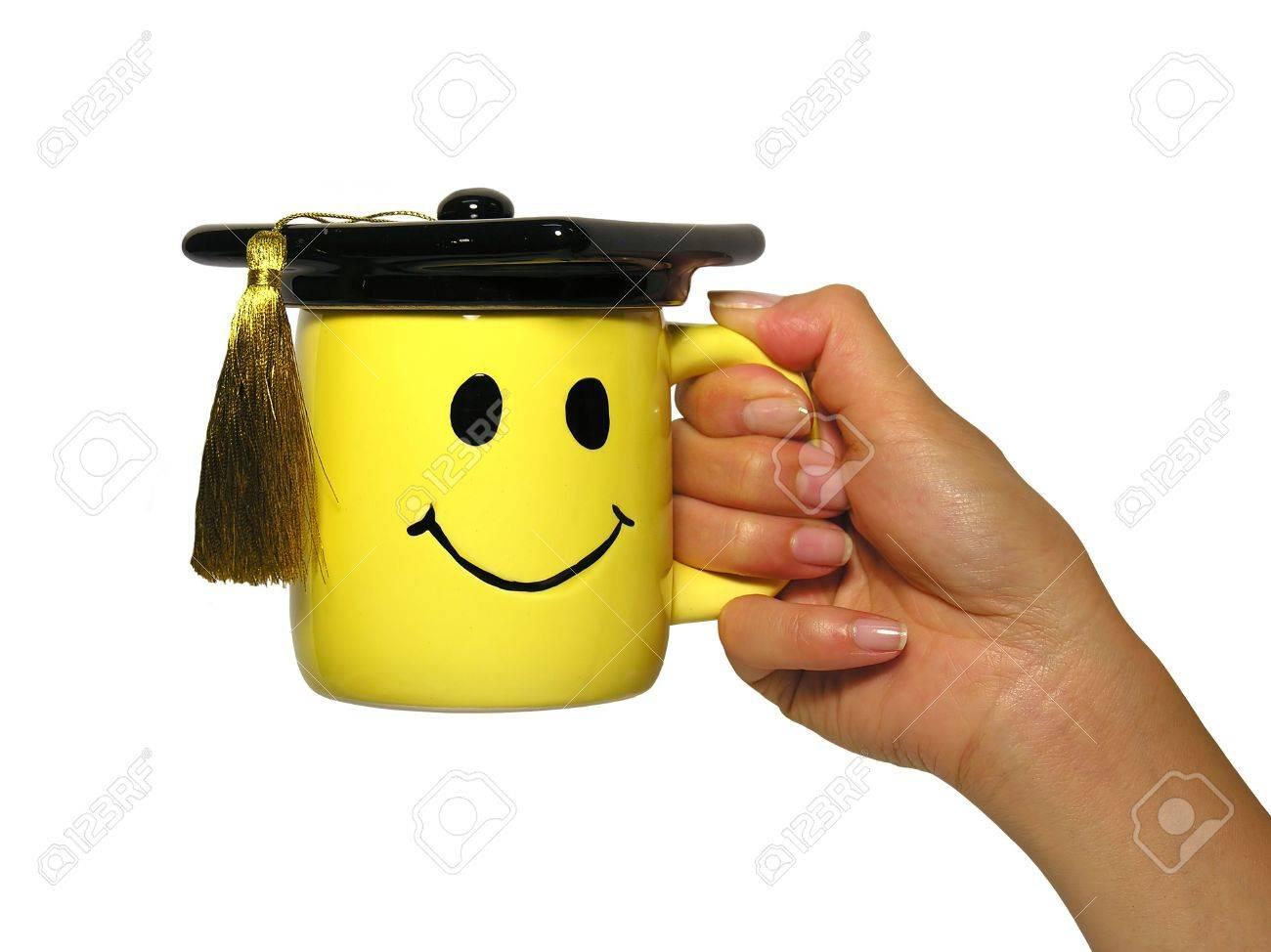 Woman holding graduation mug Stock Photo - 477318