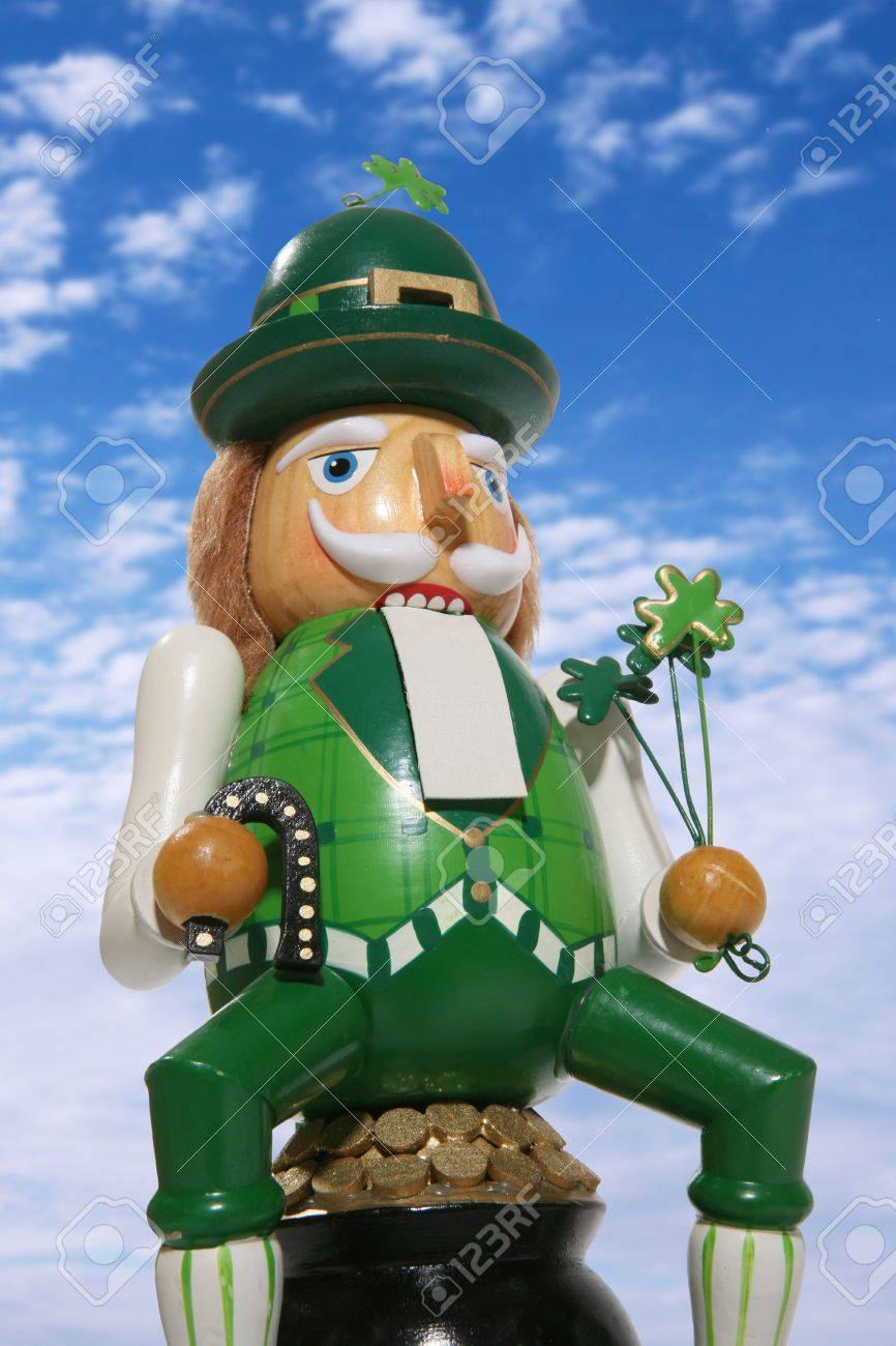 A leprechaun figure sitting on a pot of gold for Saint Patrick's Day Stock Photo - 603447